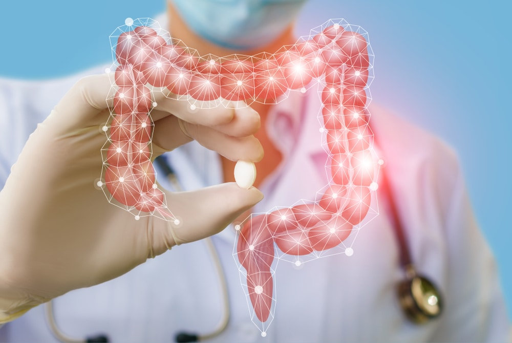 Image of a doctor treating the digestive tract with a pill by The Healthy RD