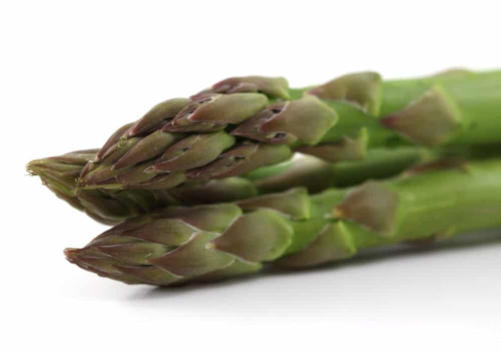 Fresh green asparagus shoots by The Healthy RD