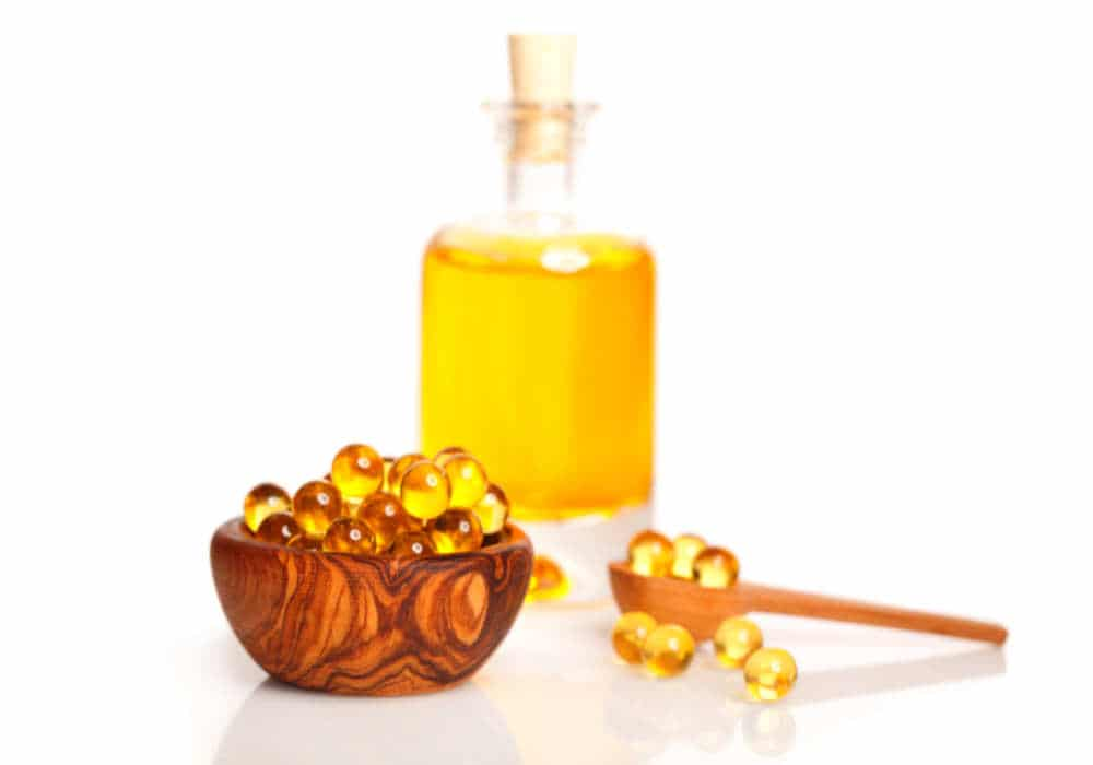 Cod liver oil gelcaps and flask of oil by The Healthy RD