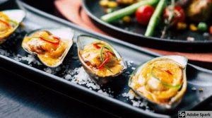 Plate of colorful oysters, a zinc-rich food by The Healthy RD