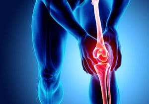 Red, painful knee scan with blue background by The Healthy RD