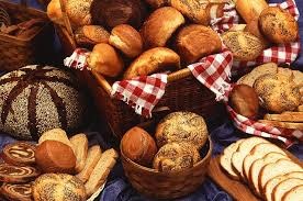 Basket of bread depicting gluten-rich foods by The Healthy RD