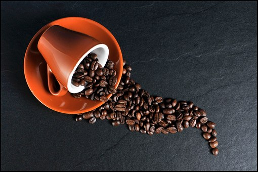 Cup of coffee beans in a bright cup by The Healthy RD