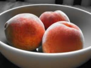 Bowl of fresh peaches by The Healthy RD