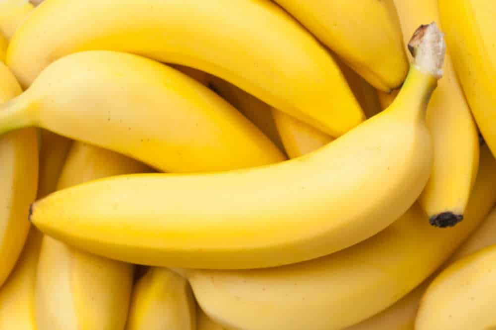 Close up of bright yellow bananas by The Healthy RD