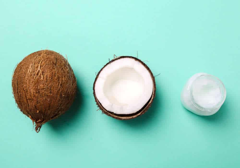Fresh whole coconut, coconut half, and coconut oil by The Healthy RD