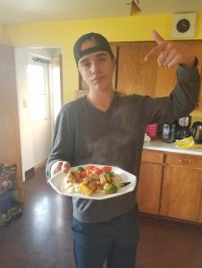 Teen cooking and entree of pan kebabs with rice by The Healthy RD