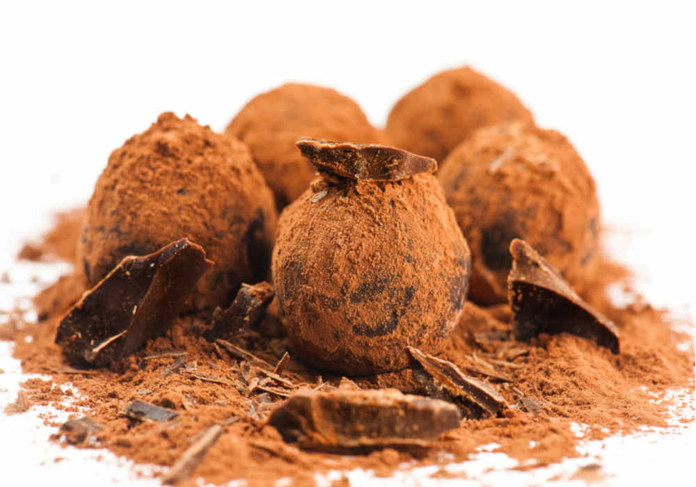 Homemade dark chocolate truffles dusted with cocoa powder by The Healthy RD