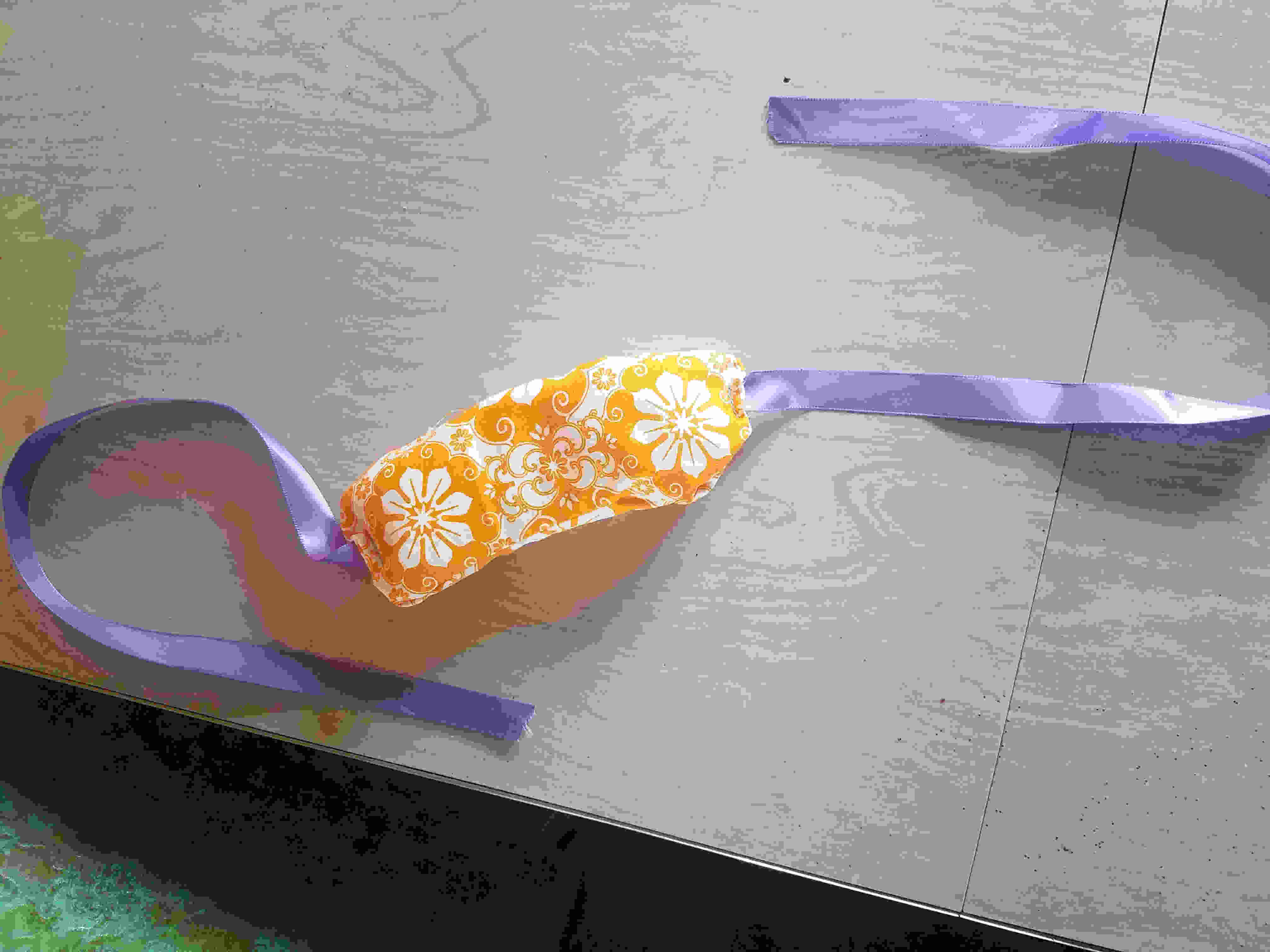 Homemade eye mask with bright orange fabric and light purple ribbon by The Healthy RD