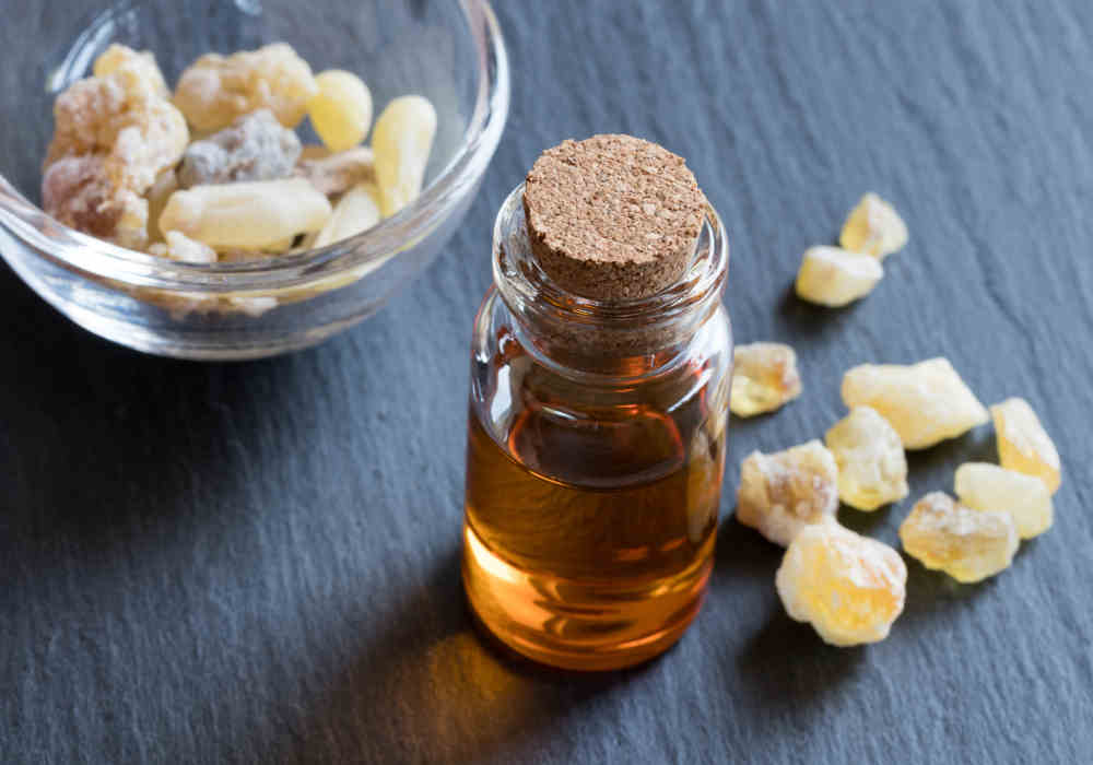 Frankincense essential oil bottle and boswellia resin by The Healthy RD