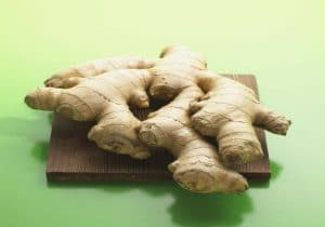 Fresh ginger root on a cutting board by The Healthy RD