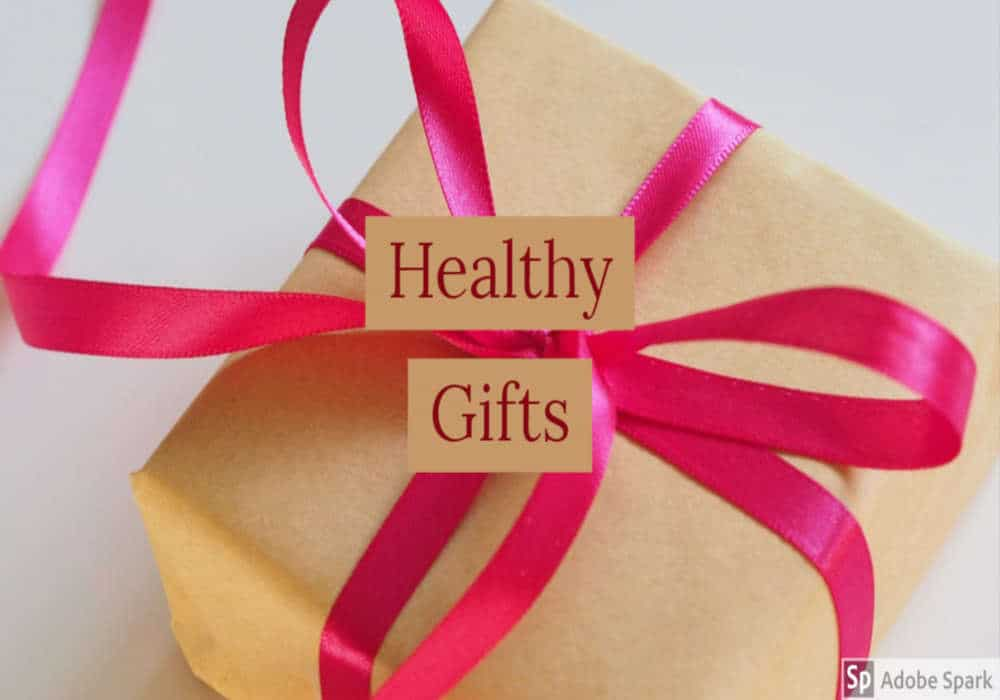 Gift box in brown paper wrapping with bright red ribbon bow and the words Healthy Gifts by The Healthy RD