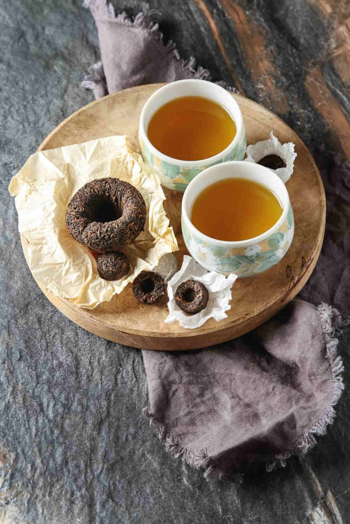 Puerh tea cup and tea cakes by The Healthy RD