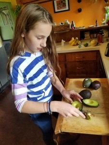 Teen cooking challenge cutting avocados by The Healthy RD