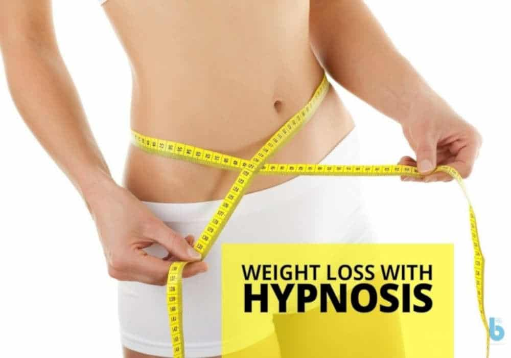 Waist with a yellow tape measure by The Healthy RD
