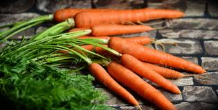 Bunch of fresh carrots with tops by The Healthy RD