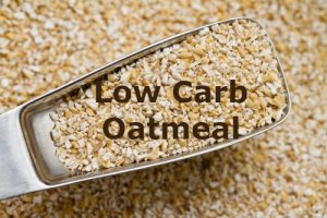 Scoop of raw oat bran depicting low carb oatmeal by The Healthy RD