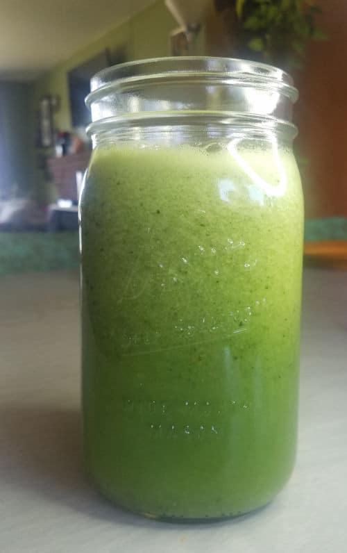Fresh green celery smoothie in a mason jar by The Healthy RD