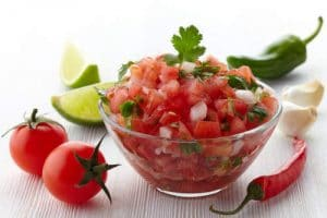 Fresh salsa bowl with tomatoes, lime, cilantro and garlic by The Heallthy RD
