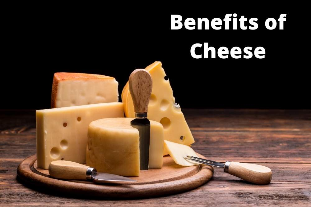 The Benefits of Cheese depicting a cheese board full of aged cheeses by The Healthy RD