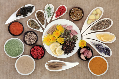 Food as medicine depicted as herbs and spices on glass dishes by The Healthy RD