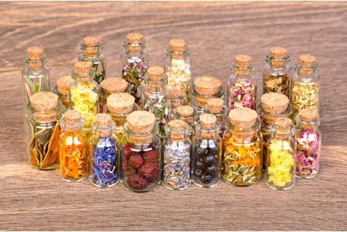 Food as medicine depicted as herbs and spices in clear glass bottles by The Healthy RD