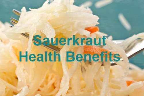 Fresh, raw sauerkraut on a fork depicting sauerkraut health benefits by The Healthy RD