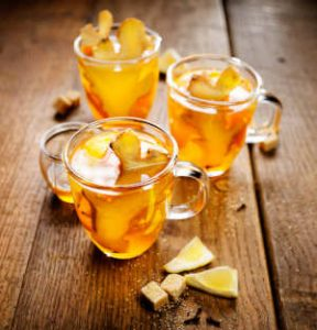 Ginger tea with fresh ginger slices in clear tea mugs by The Healthy RD