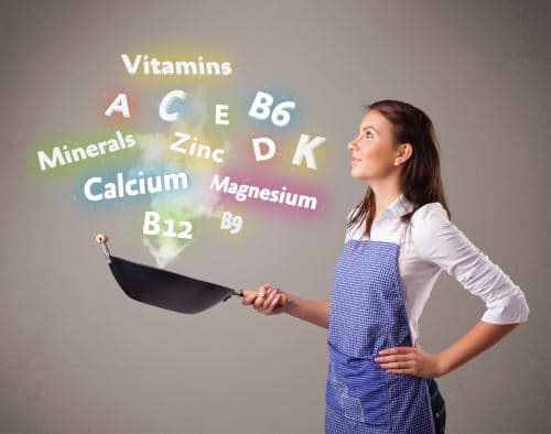 Woman cooking depicting vitamins, minerals in a pan by The Healthy RD