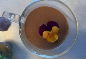Cacao elixir drink with edible pansy by The Healthy RD