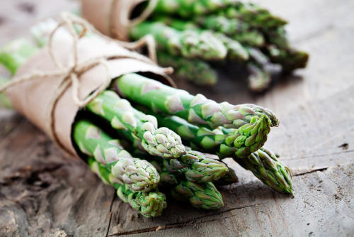 Fresh asparagus spear wrapped in paper by The Healthy RD