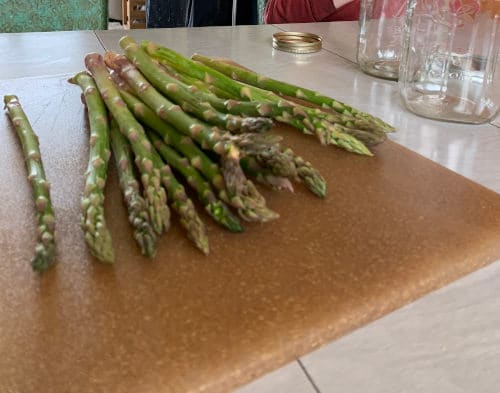 Fresh asparagus spears on a cutting board by The Healthy RD