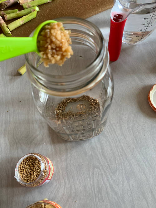 Mason jar with garlic and spices by The Healthy RD