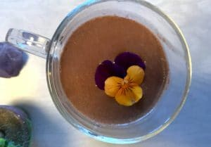 cacao elixir drink with edible flower by The Healthy RD