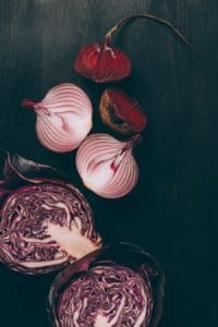 Beets and cabbage on a dark background by The Healthy RD