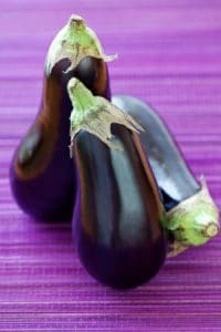 Purple eggplant on purple background by The Healthy RD