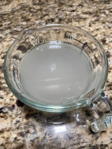 Brine in a measuring cup by The Healthy RD