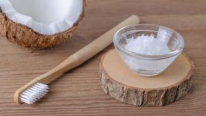 Homemade toothpaste with a bamboo toothbrush by The Healthy RD