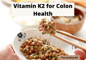 Image of vitamin K2 rich natto in a white bowl with writing Vitamin K2 for colon health by The Healthy RD