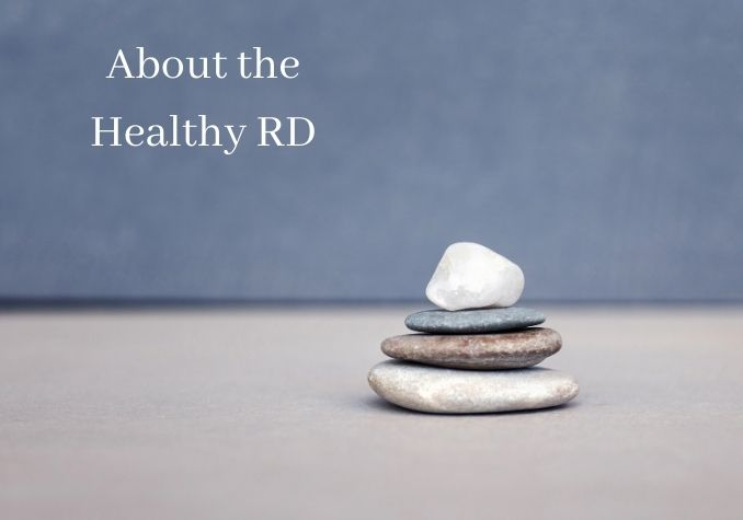 Image of 4 flat stones stacked on earth toned colors with the writing About the Healthy RD by The Healthy RD
