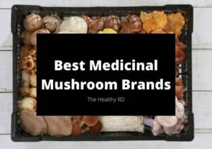 Tray of many varieties of mushrooms with writing best medicinal mushroom brands by The Healthy RD