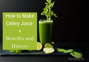 Photo of large glass of celery juice with a celery stalk on a black background with the words how to make celery juice + benefits and history by The Healthy RD