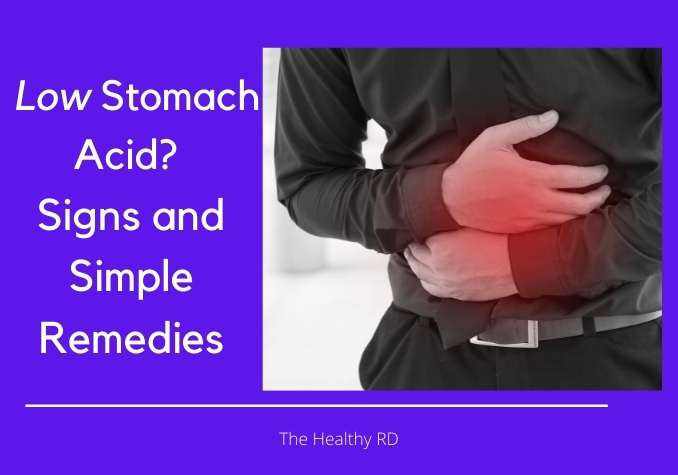 Image of a man holding his stomach on a purple background with wording low stomach acid? Signs and simple remedies by The Healthy RD