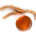 Image of reishi tea and sliced reishi mushrooms for the best reishi mushrooms supplement post by The Healthy RD
