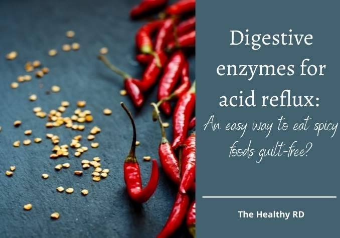 Image of hot peppers on a slate gray background with pepper seeds and writing stating Digestive enzymes for acid reflux: An easy way to eat spicy foods guilt free? By the Healthy RD